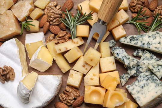 Various fancy cheeses on a board