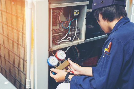 HVAC tech looking at a customer's system