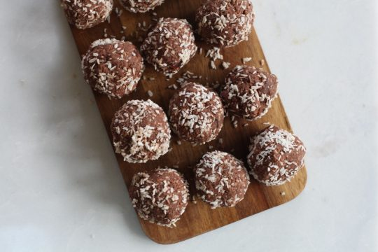 No bake chocolate energy balls with coconut shreds on top