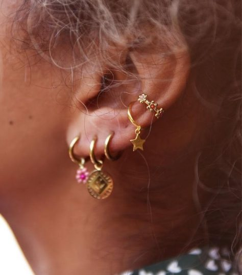 Woman with gold flower gem ear cuff