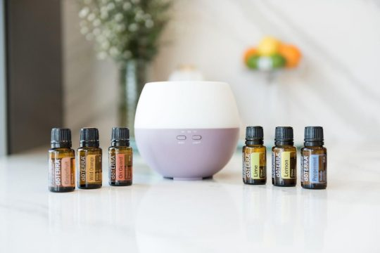 DoTerra essential oils next to a diffuser