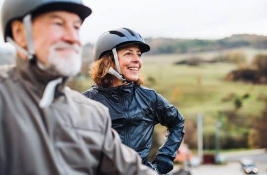 Man and woman enjoying a bike ride together