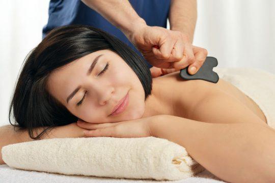 Woman getting a gua sha massage