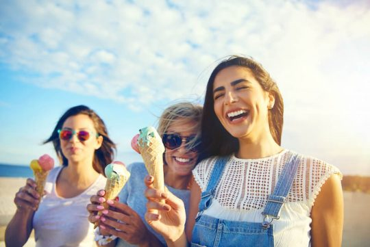 Girls having fun getting ice cream