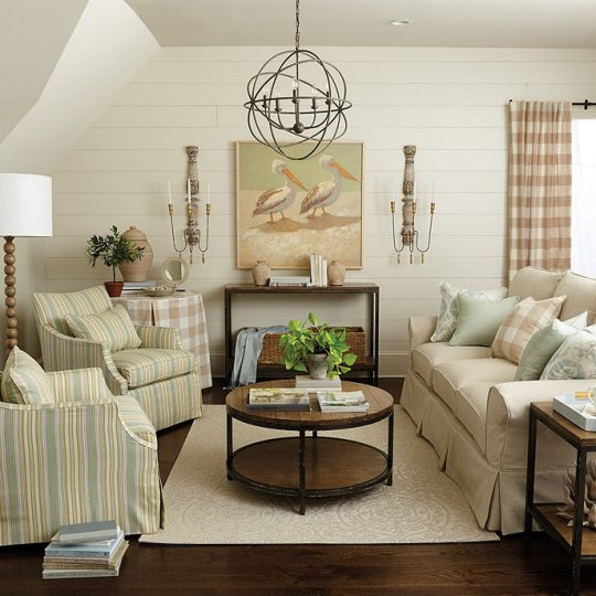 Nautical room with sofa and two accent chairs covered with Ballard Designs covers.