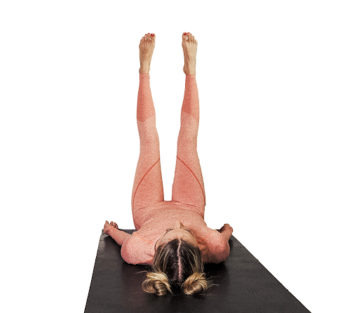 Woman with legs up the wall