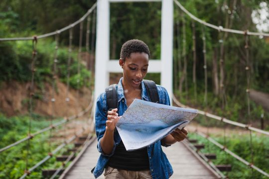 Woman looking at a map while she travels