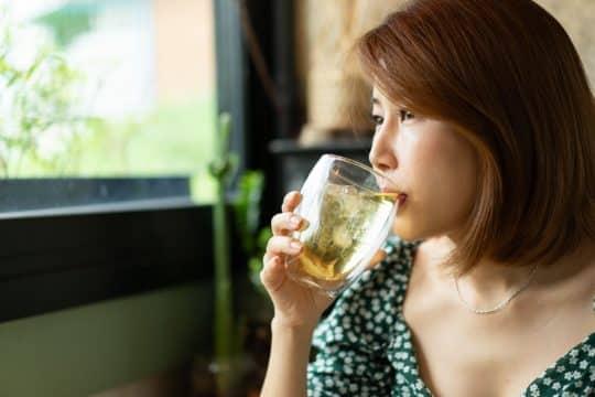 Woman drinking a prebiotic soda