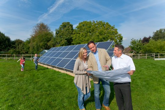 A family talking with someone about installing solar panels