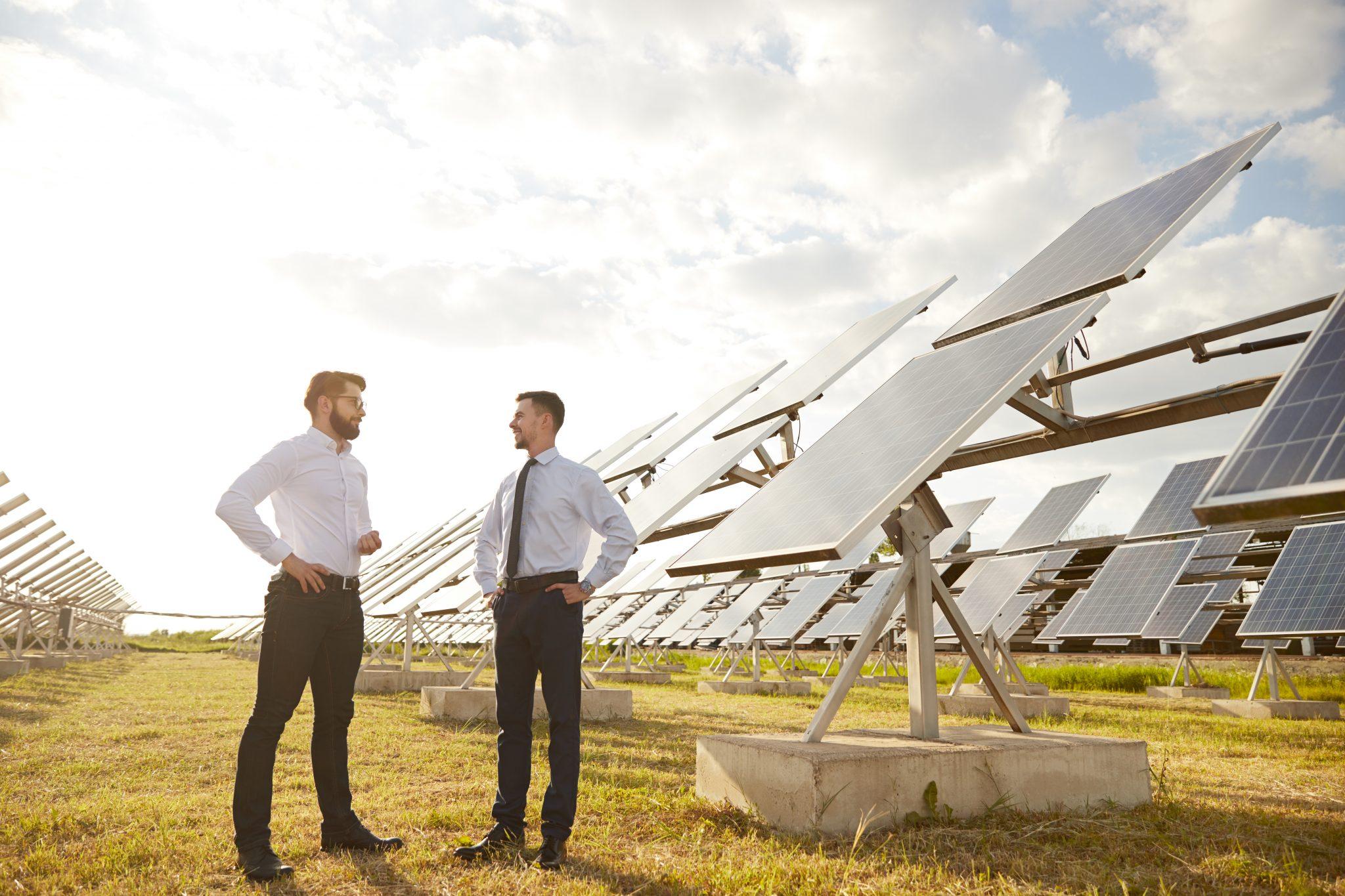 Two men talking about bifacial solar panels
