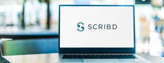 Laptop open to a SCRIBD screen