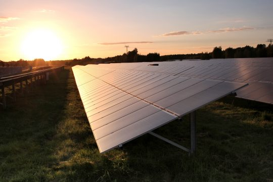 Bifacial solar panels in a row