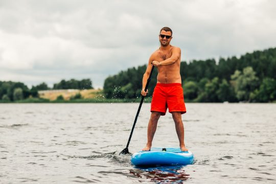 Man stand up paddle boarding
